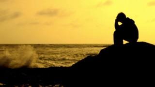 Praying At Ocean